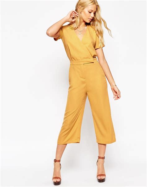 womens yellow jumpsuit asos tailored wrap jumpsuit with midi leg in yellow lyst