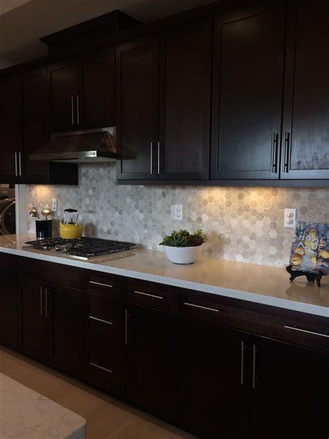 dark brown kitchen cabinets light quartz countertop