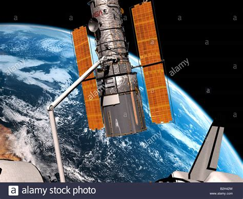 NASA Hubble Space Telescope docked to shuttle for repair ...