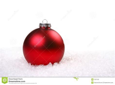 single red shiny christmas ornament   snow stock