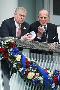 Britain's Prince Andrew (L) talks to his father Prince ...