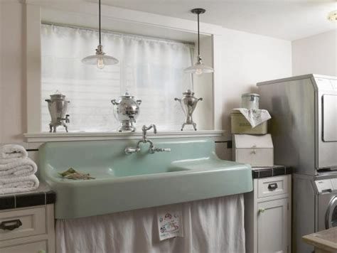 white laundry room features mint green sink hgtv