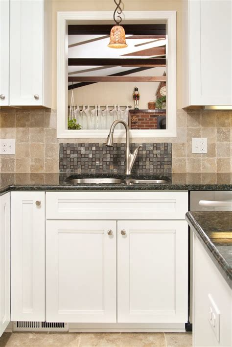pendant light kitchen sink kitchen transitional with