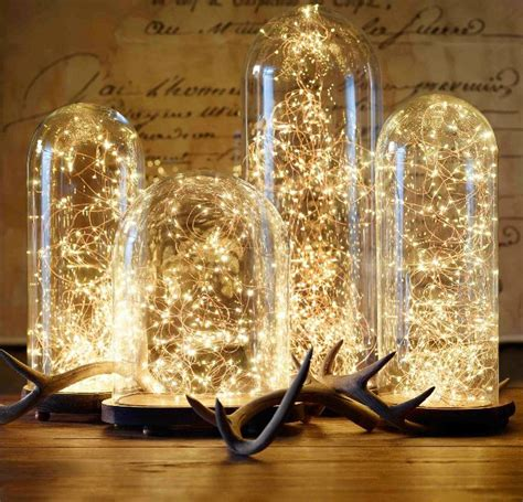 glass cloche and starry string lights from