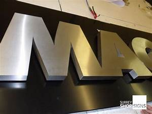 brushed stainless steel 3d shop sign metal letters With large gold metal letters