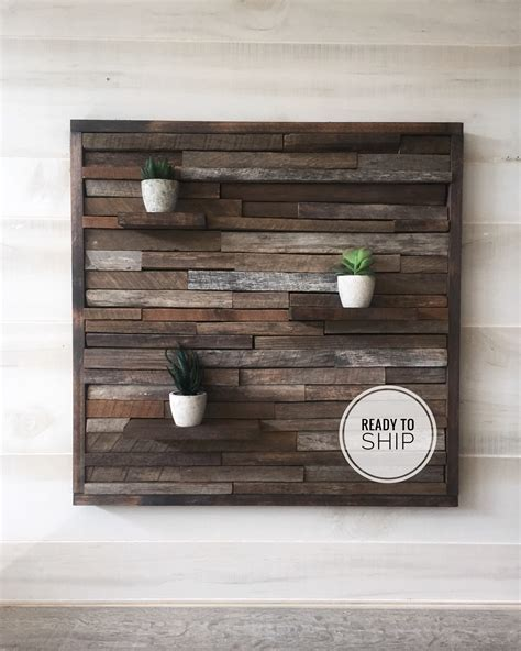 All of these decorating ideas using salvaged wood will give your space some rustic appeal. Reclaimed wood wall art, wood wall decor, rustic art, rustic wall decor, modern farmhouse ...