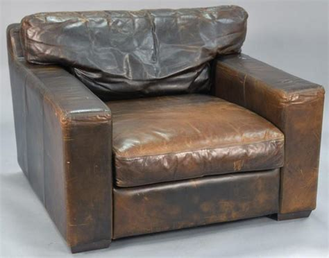 Leather Trend Pair Of Oversized Armchairs. Ht. 30in., Wd. 46
