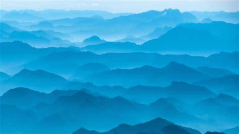 mountain silhouettes   mist   brandenburg alps