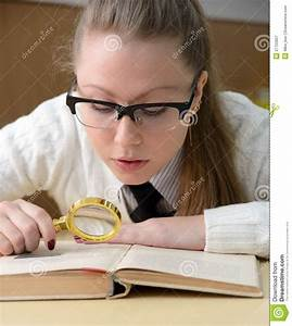Woman Reading A Book With A Magnifying Glass Royalty Free ...