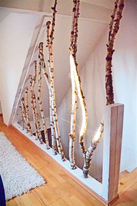 kreatives treppengelaender aeste als trennwand und
