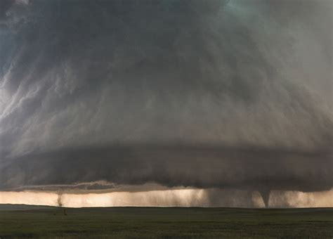 Photographer Captures Twin Tornados Under Huge Supercell
