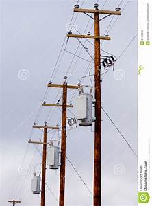 Row Of Utility Poles Power Cables And Transformers Stock