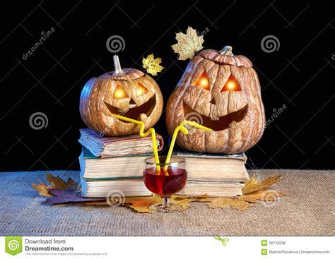 funny halloween pumpkins drinking wine stock photo image
