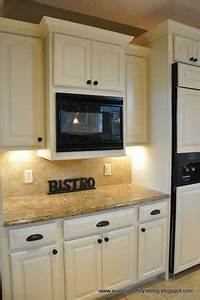white cabinets with bronze knobs and cup pulls i think i With best brand of paint for kitchen cabinets with jc penny wall art