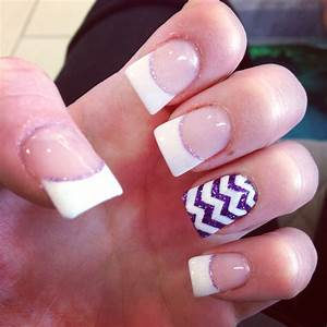 White French tips with a purple and white design on ...