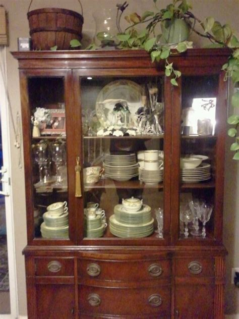 drexel  china cabinet filled   grandfathers