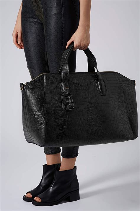 wheeled garment bag uk lyst topshop croc winged luggage bag in black