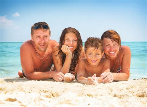 Family Having Fun At The Beach Stock Photo