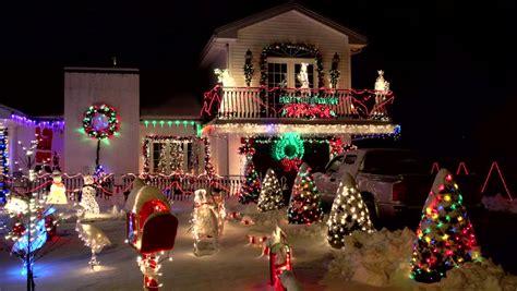 santa claus climbs  snowy chimney front yard christmas