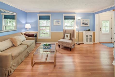 Country Living Room With Chair Rail Hardwood Floors In