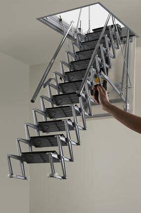 escalera  atico  control retractil en aluminio