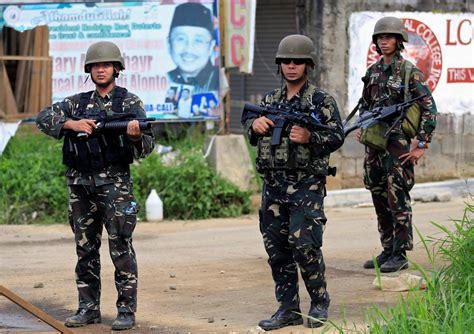 siege city scores of dead bodies litter besieged marawi city in