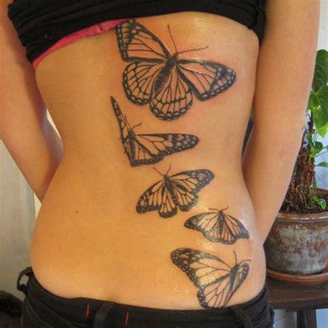 papillons monarque dos femme  tatouer tatouage femme