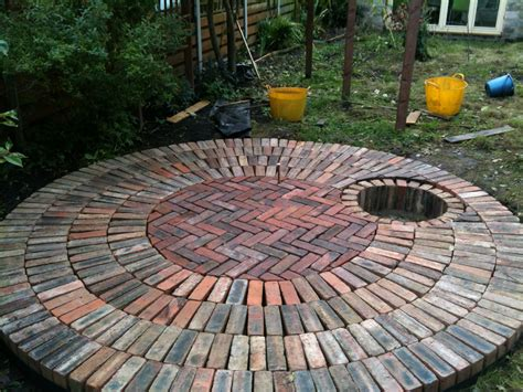 circular reclaimed brick patio with recessed pit