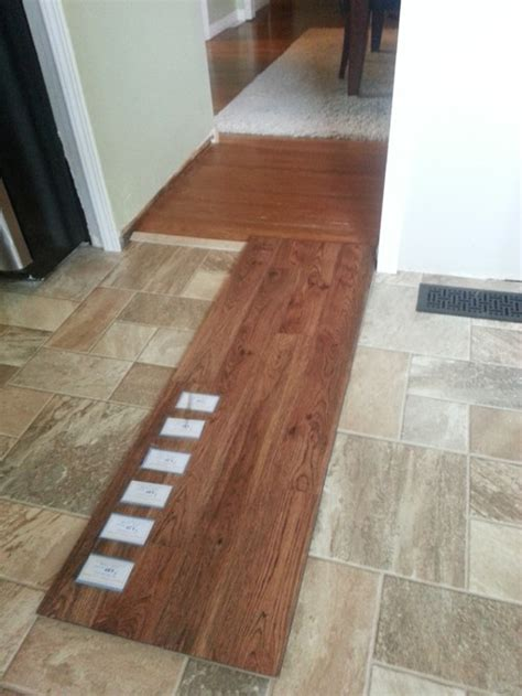 tile flooring next to hardwood adding laminate wood floor to adjacent room with hardwood