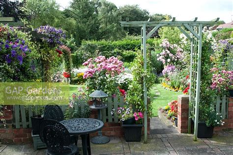 Gap Gardens  Archway On Patio Leading On To Colourful