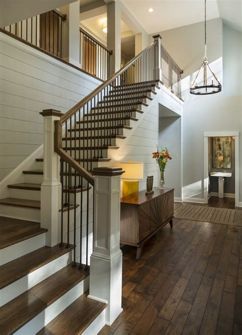 Entryway with rustic wood floors, L-shaped stairway