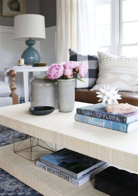 If you live in a smaller house or apartment try different coffee table shapes to give a different vibe to your room. Parley Project Reveal (STUDIO MCGEE)   Coffee table cover, Coffee table styling, Design