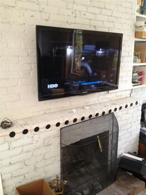 Fireplace Tv Pictures by Tv Installation A Brick Fireplace 43254 Watershed