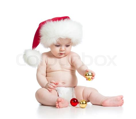 baby girl with santa claus hat stock photo colourbox