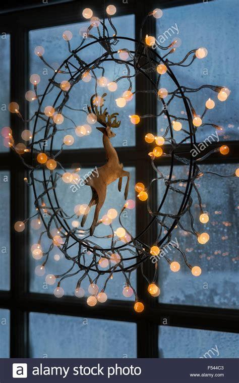 christmas lights hanging on window indoors iceland stock
