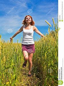 Woman Running Through A Wheat Field Royalty Free Stock ...