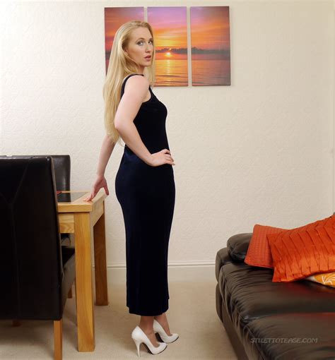 stilettotease This Sexy Lady Wearing Shiny Black Classic