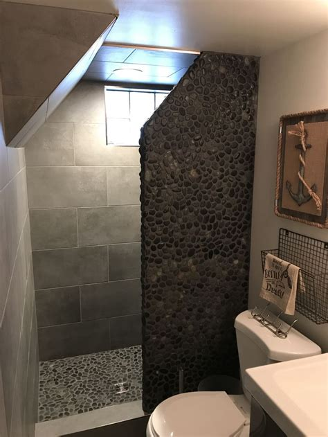 charcoal black pebble tile   small bathroom