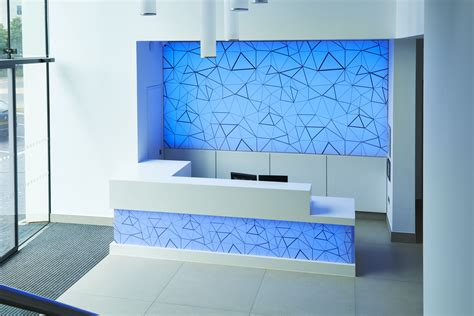Highlights bespoke wall panel system with an engineered attachment framework. Zeta Specialist Lighting RGB Embedded LED panels light up feature wall and reception desk ...