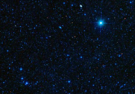 space images galaxy packs big star making punch