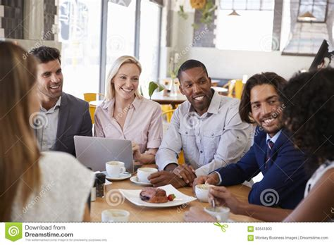 In the past, coffee was associated with increased health risks. Group Of Businesspeople Having Meeting In Coffee Shop Stock Image - Image of computer, female ...