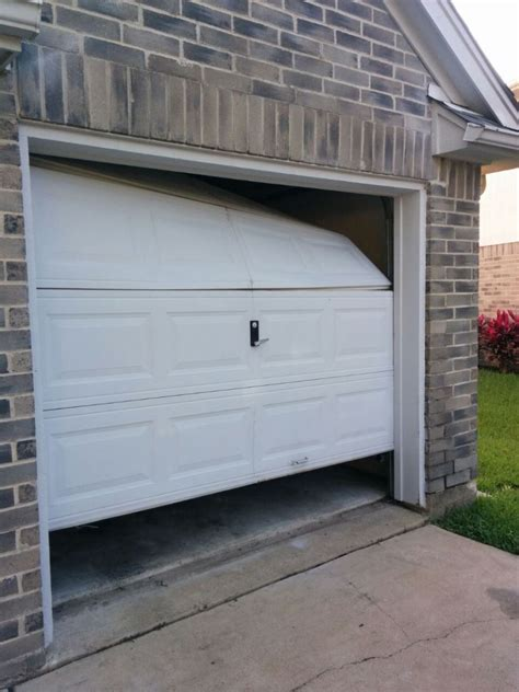 Blog  Do You Dare To Service Major Breaks On Your Garage Door