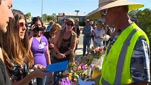 Community raises thousands for flower vendor robbed on ...