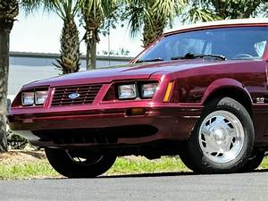 Maroon Ford Mustang with 30117 Miles available now!