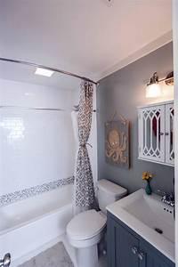 small bathroom makeovers after beach flip after the makeover the space looks relaxing and spacious with new floors a ...