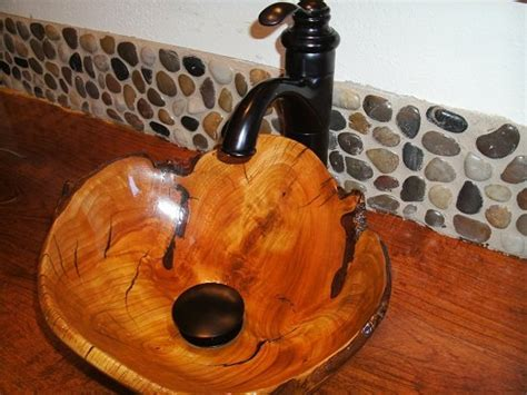 Carved Sink and mesquite counter   by scott shangraw