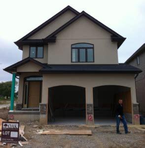 stucco  dark soffit  fascia  wellington house