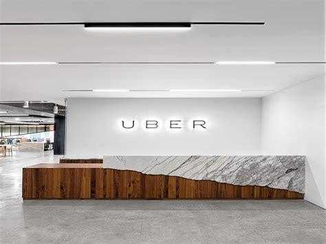 White receptionist desk, uber office design uber office
