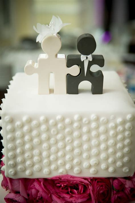 small polka dot wedding cake  puzzle piece cake topper