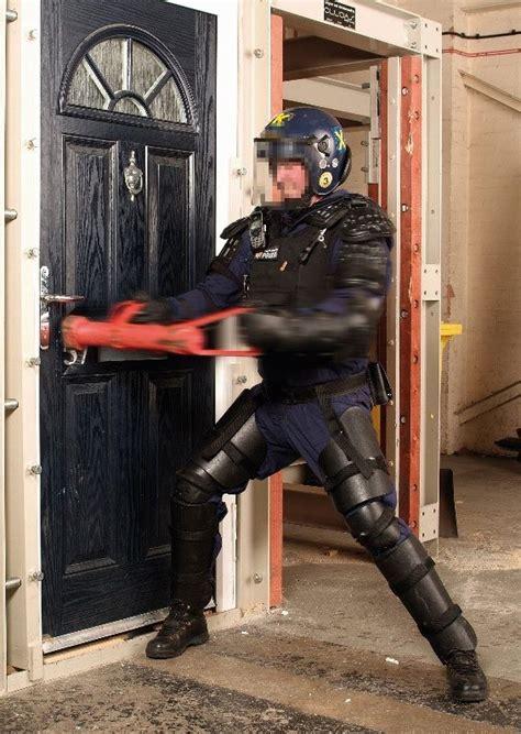 tube   guy  swat team  carrying  bang  doors   movies